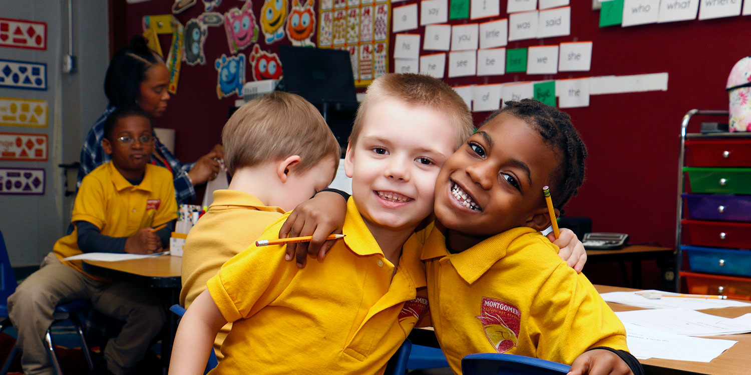 Smiling students in a classroom.
