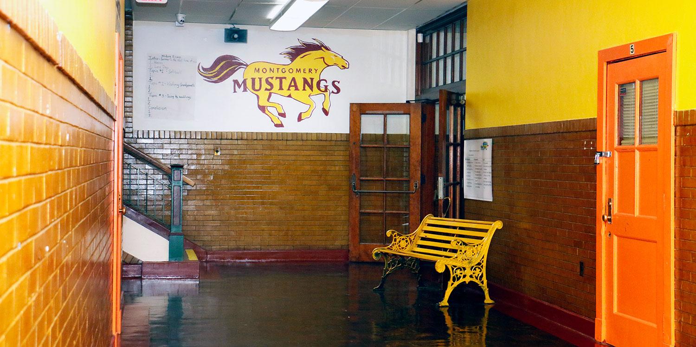 Montgomery prep hallway with bench.